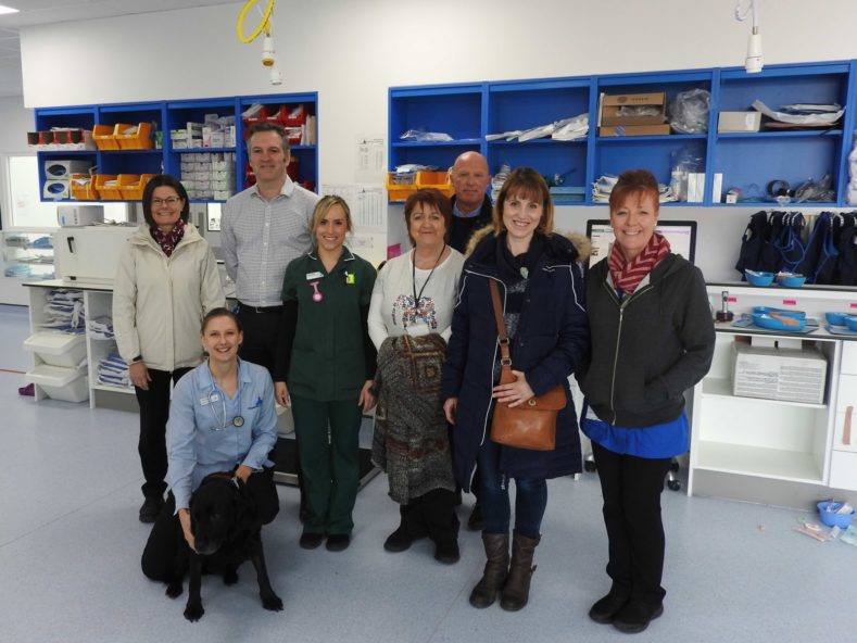 Royal Surrey Oncology staff with Fitzpatrick Referrals Oncology team and black lab Holly